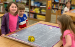 Three students with the bee bot