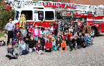 Everybody in front of the fire truck