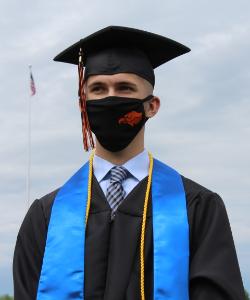 graduate wearing a BP face mask