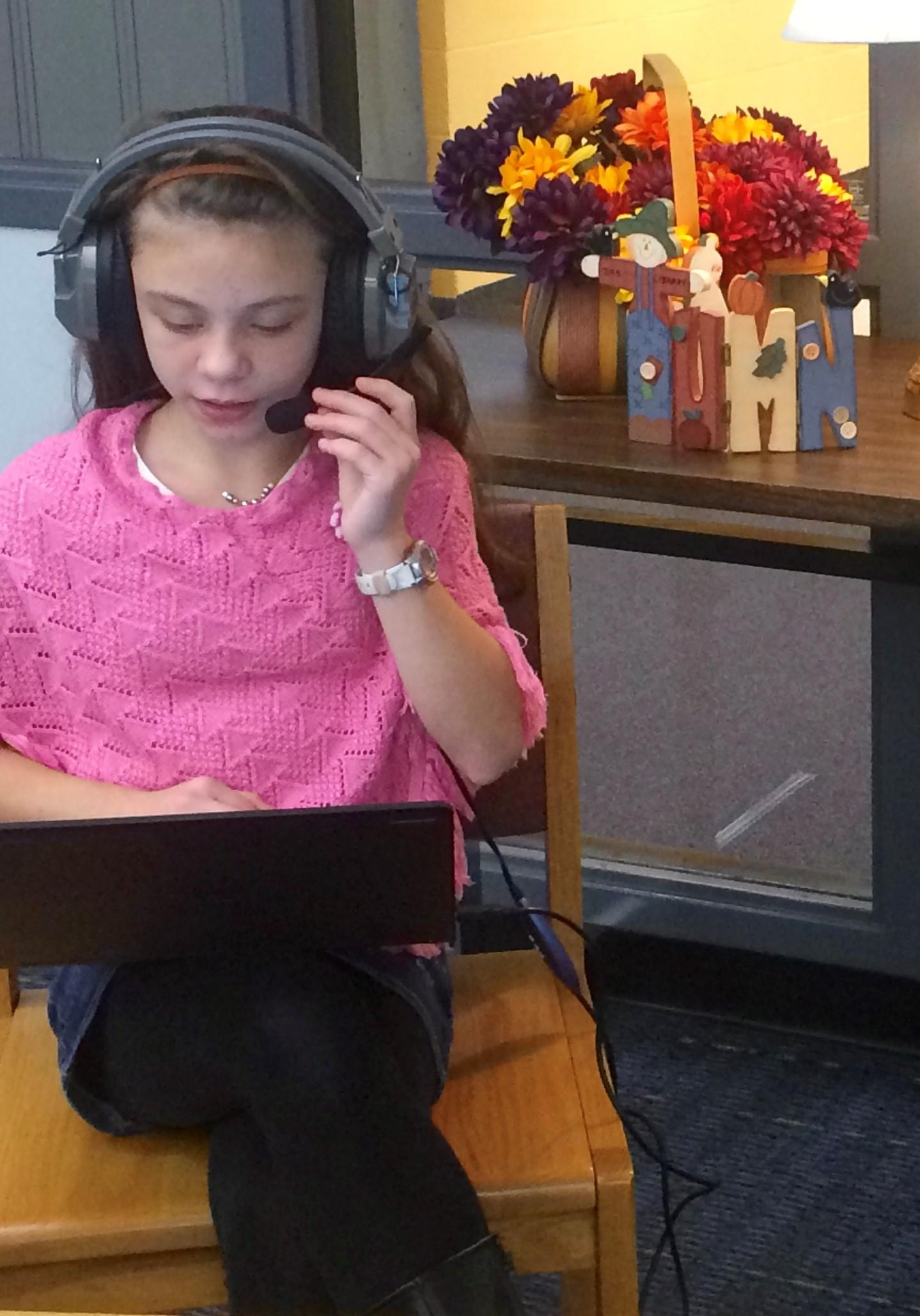 student recording essay