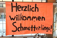 A sign welcoming the German students