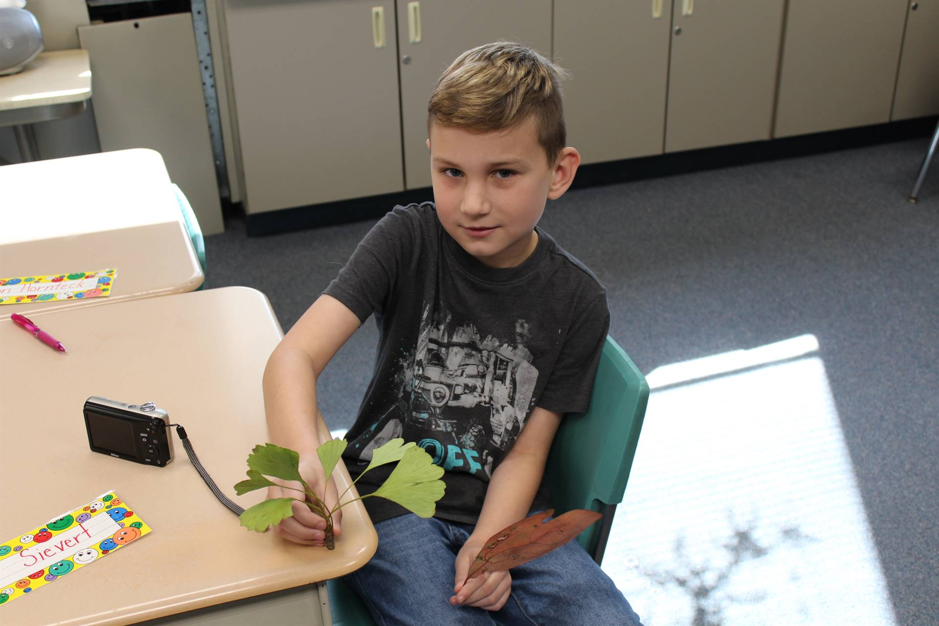 A student with a leaf