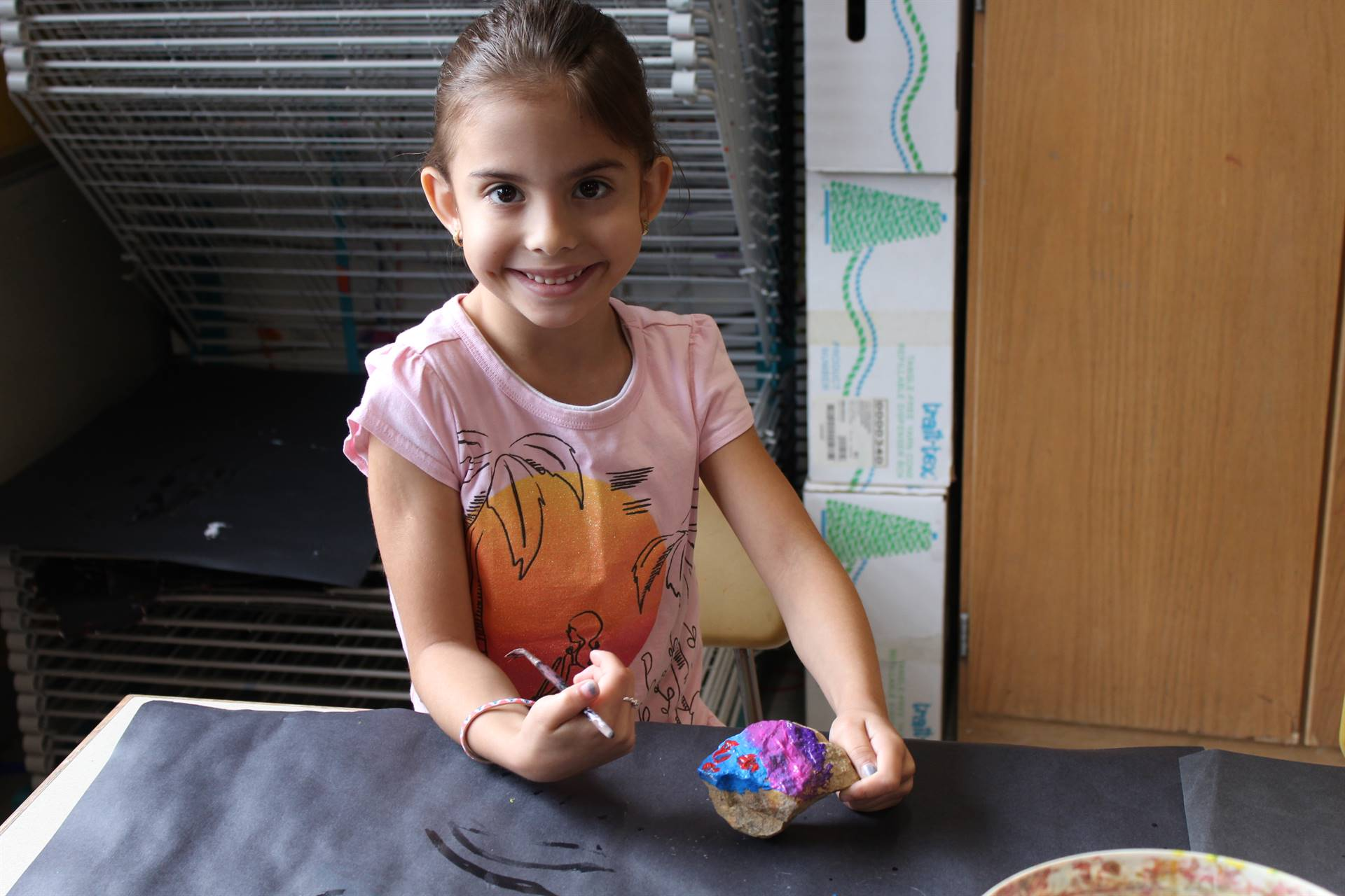 Second graders paint their rocks for the rock garden