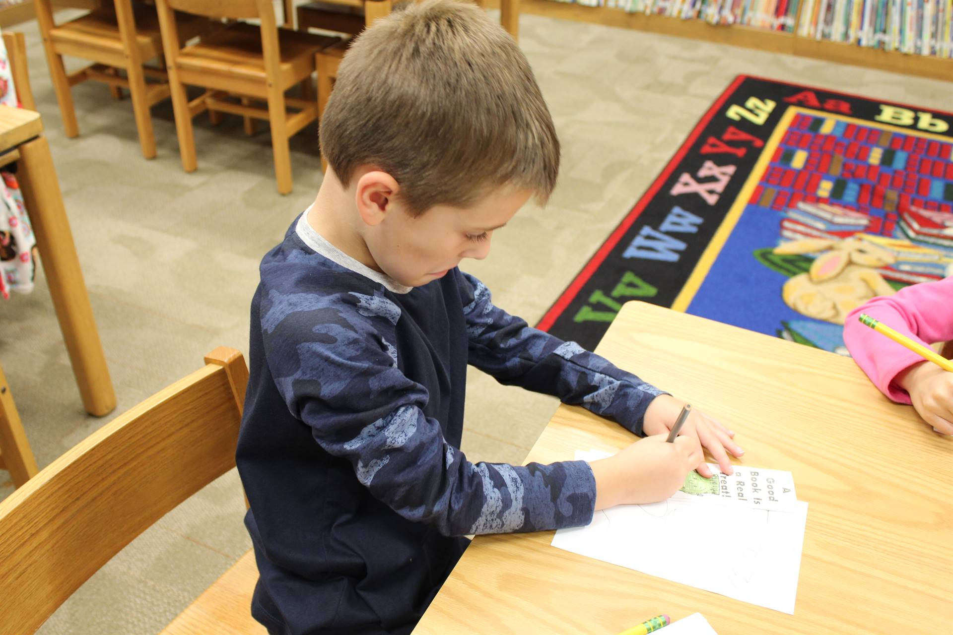 Students decorate bookmarks on PJ Day