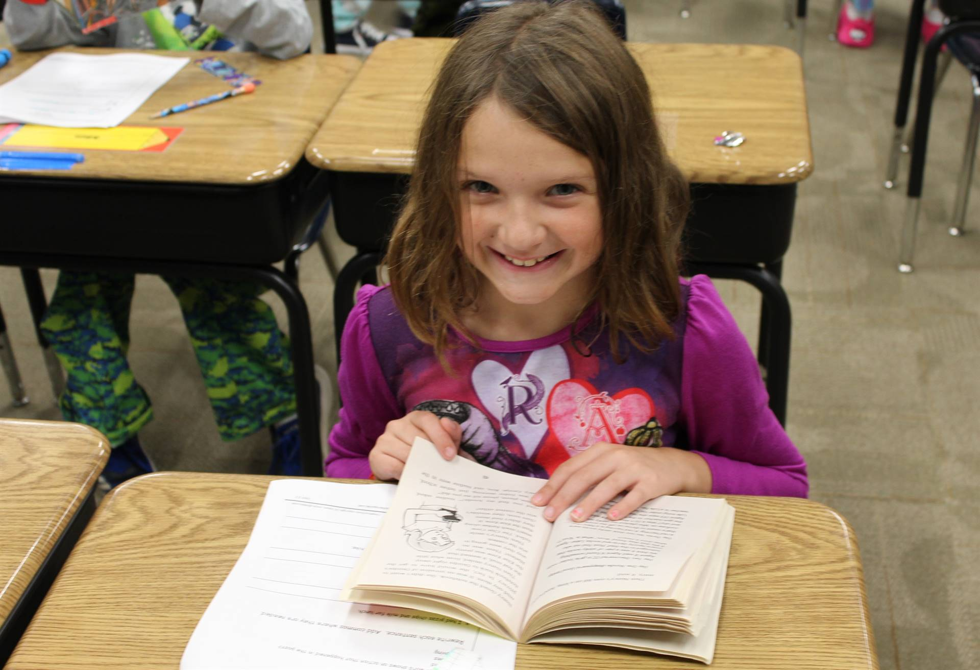 Second graders enjoy reading chapter books