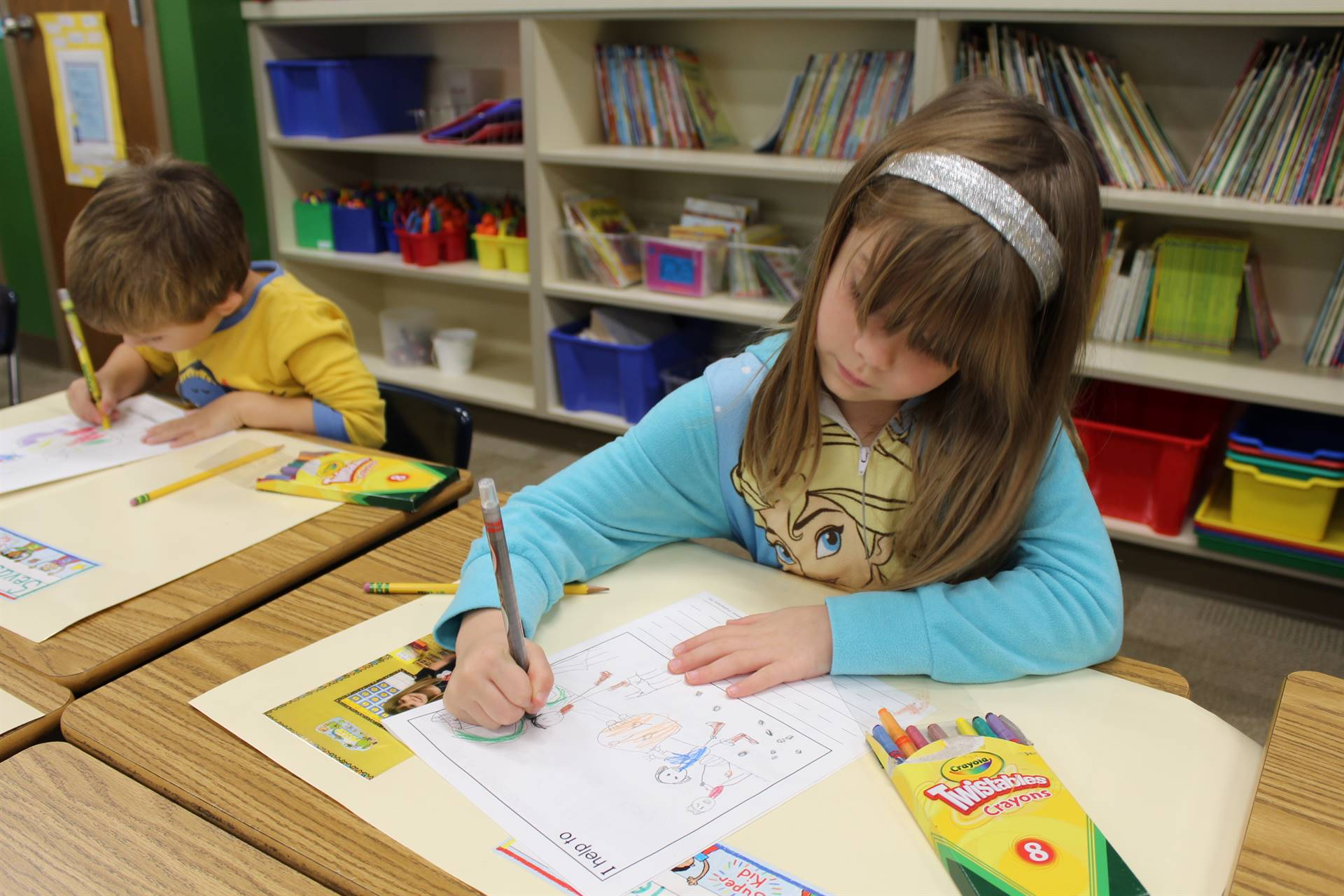 Students draw how they help out at home
