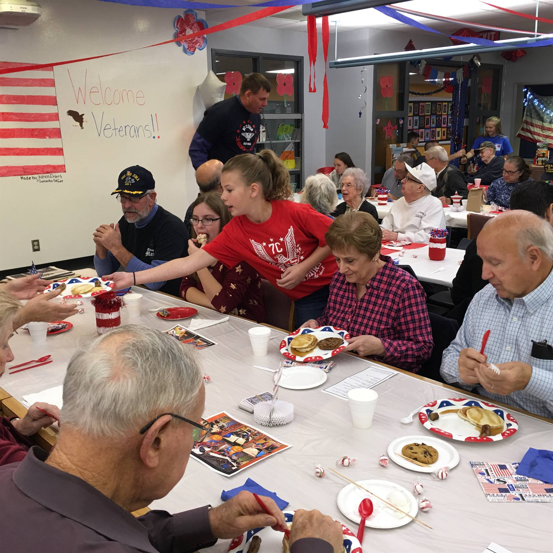 Serving pancakes and sausage to the Veterans