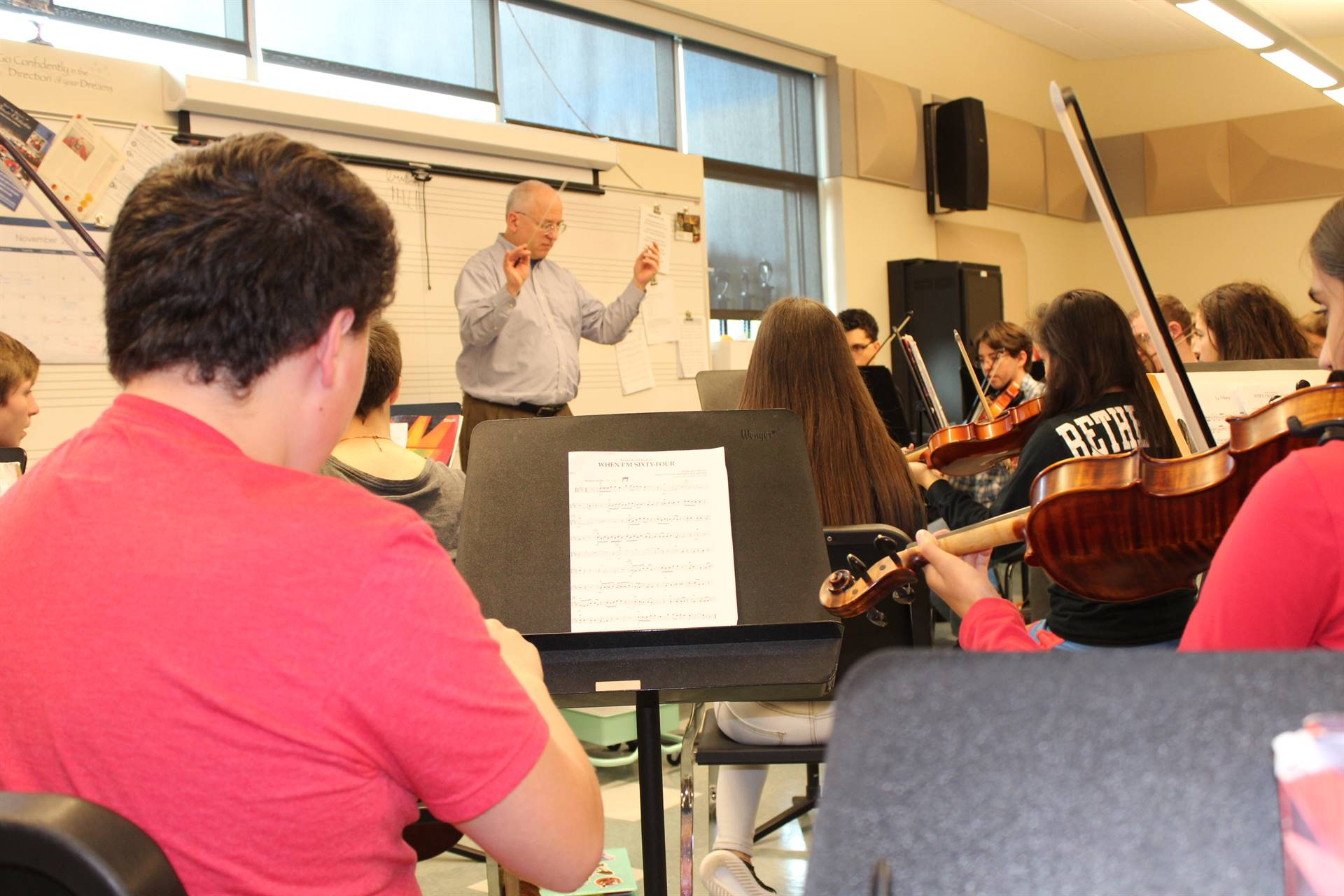 Dr. Davidson works with the BPHS String Orchestra