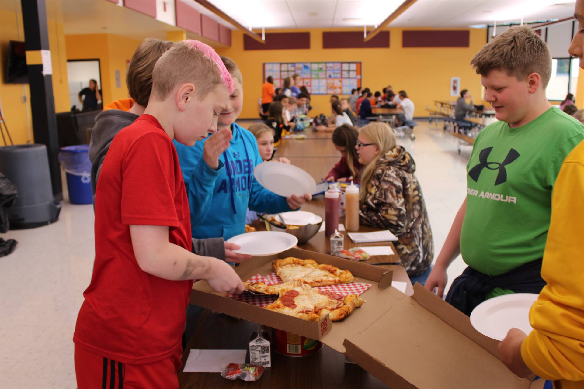 IMS students serving their pizza