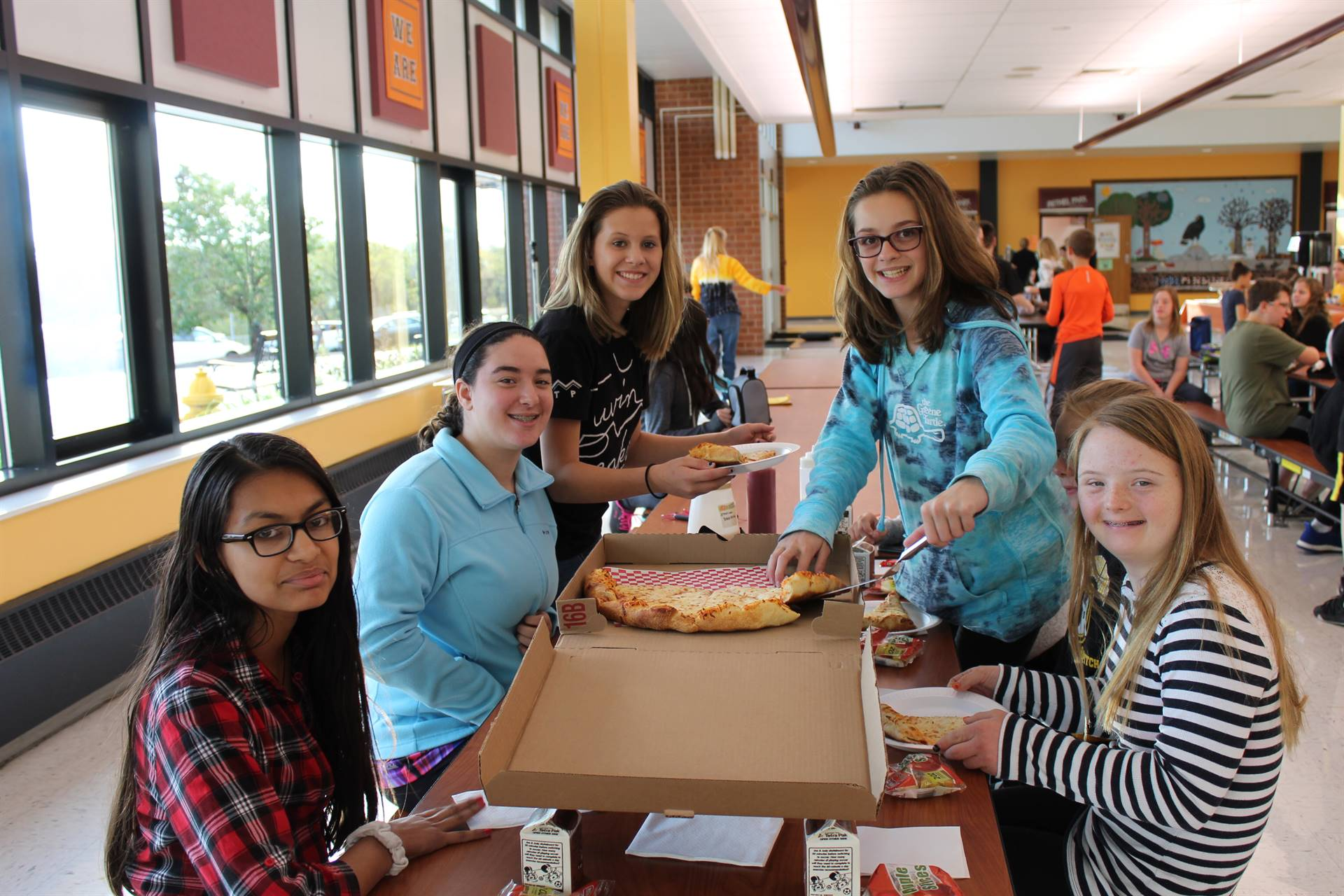 IMS students with their pizza