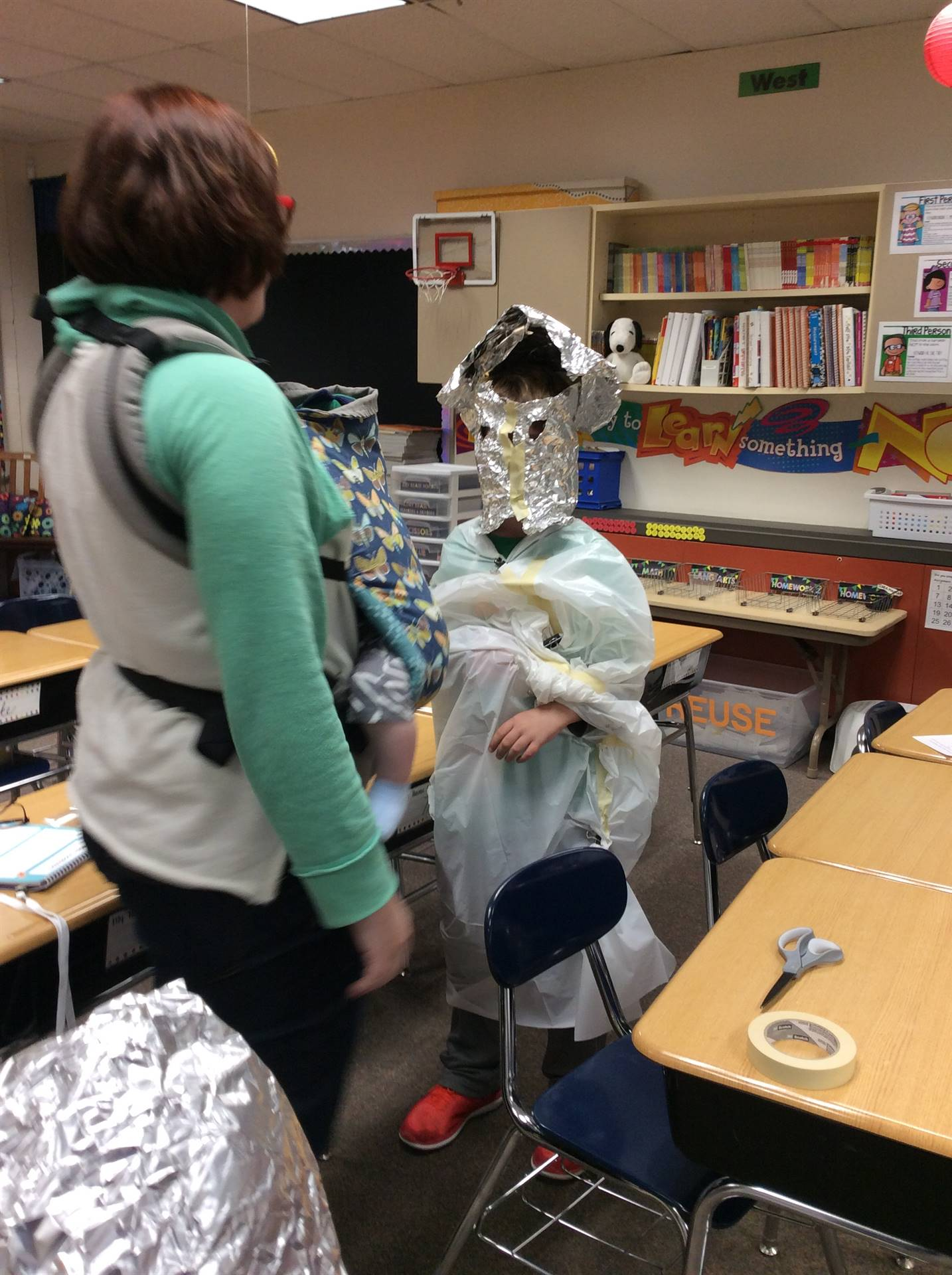 Students model their protective clothing