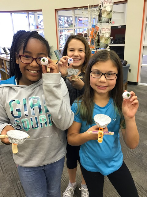 Students have fun with their eyeball ping pong balls