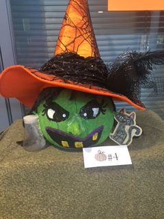 pumpkin decorated as a witch