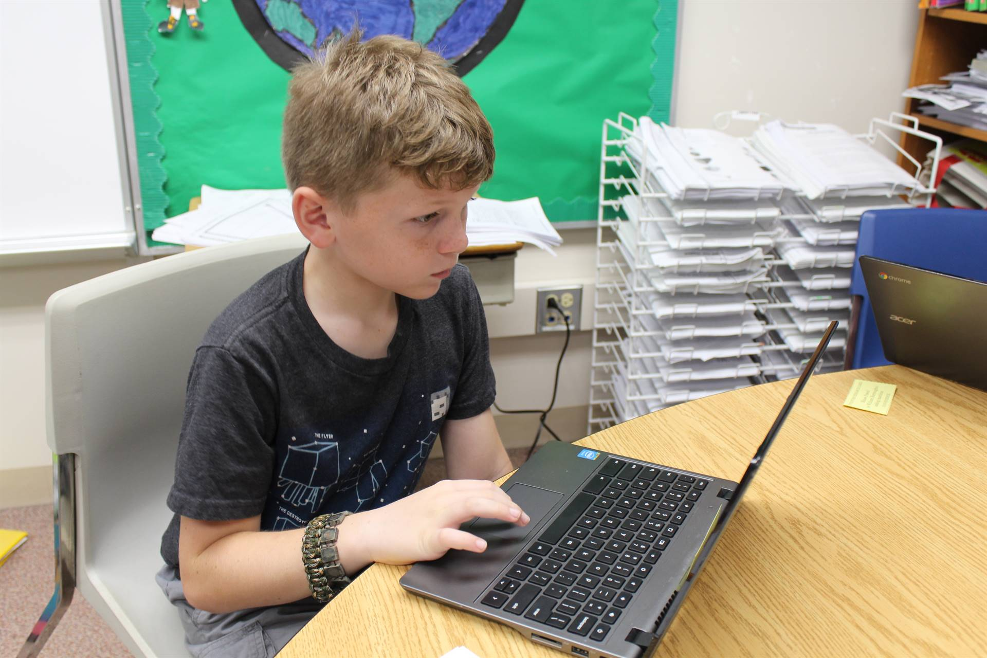 Gifted students researching inventions