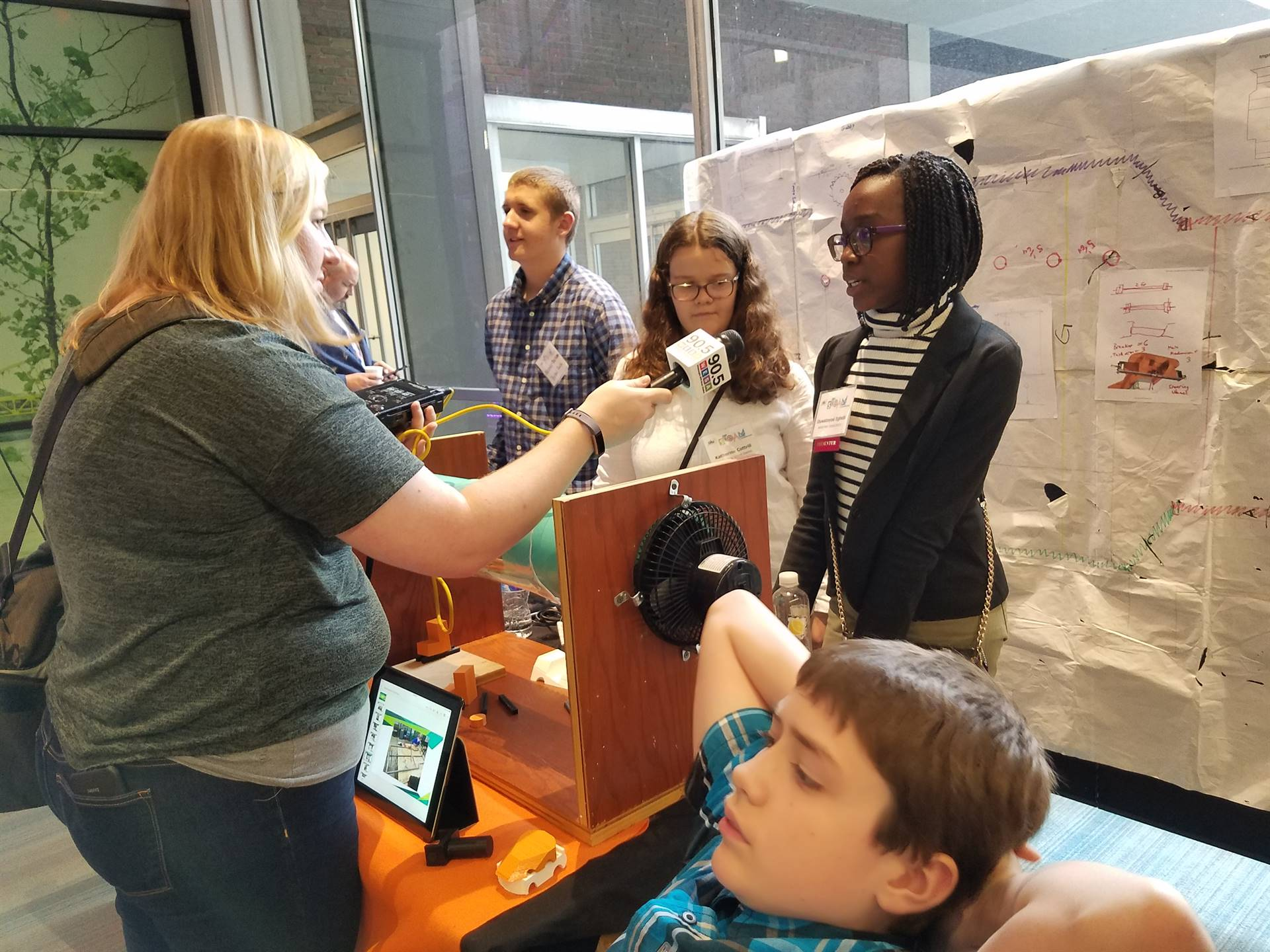 Students at the Steam Showcase 2017 being interviewed by WESA - our local NPR radio station