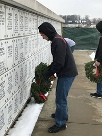 Laying wreaths at the Cemetery of the Alleghenies