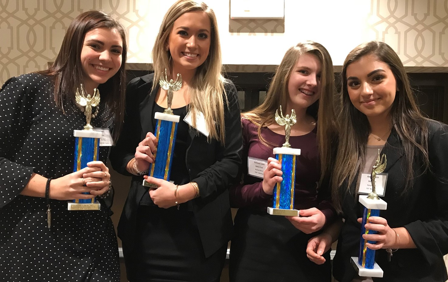 Four of the 49 BPHS DECA Conference Winners