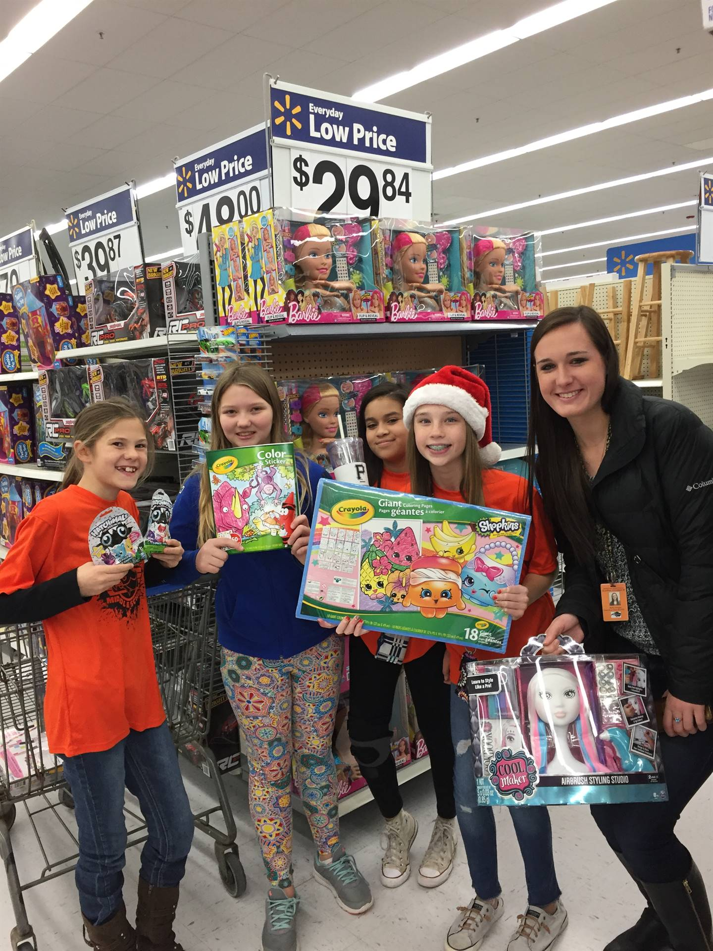 Students with some of the presents they purchased for Operation Santa