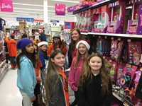 Students shopping in small groups to purchase presents for Operation Santa