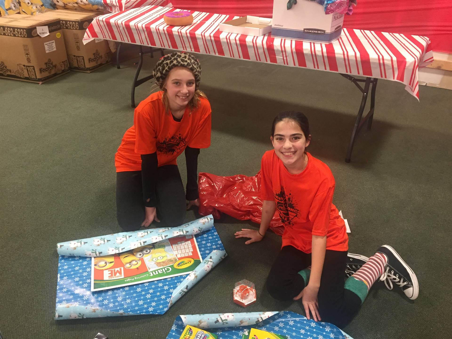 Students wrapping the presents