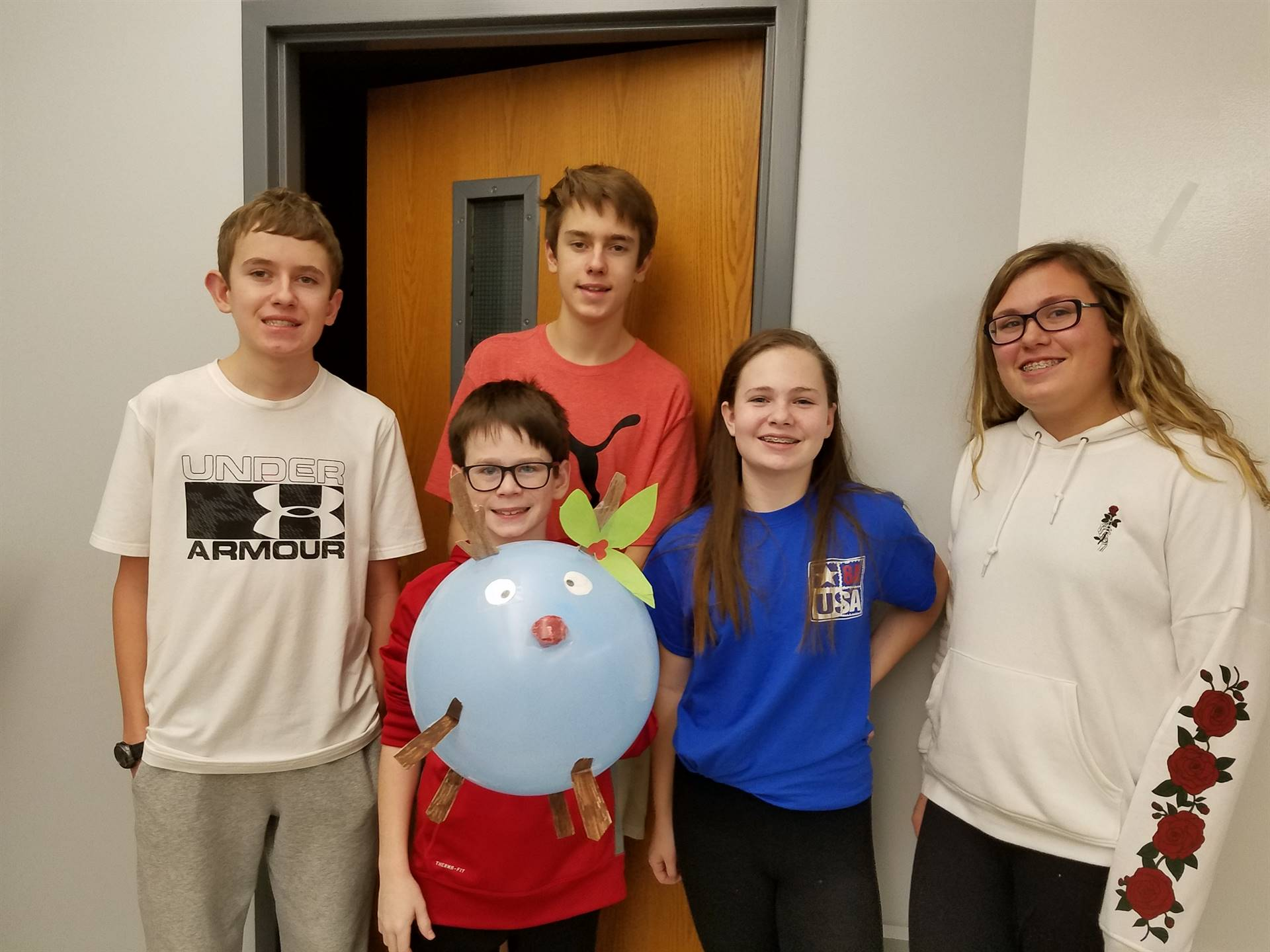 Team 8A competes using helium balloons to learn about neutral buoyancy.