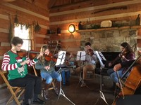 Performing at the Oliver Miller Homestead