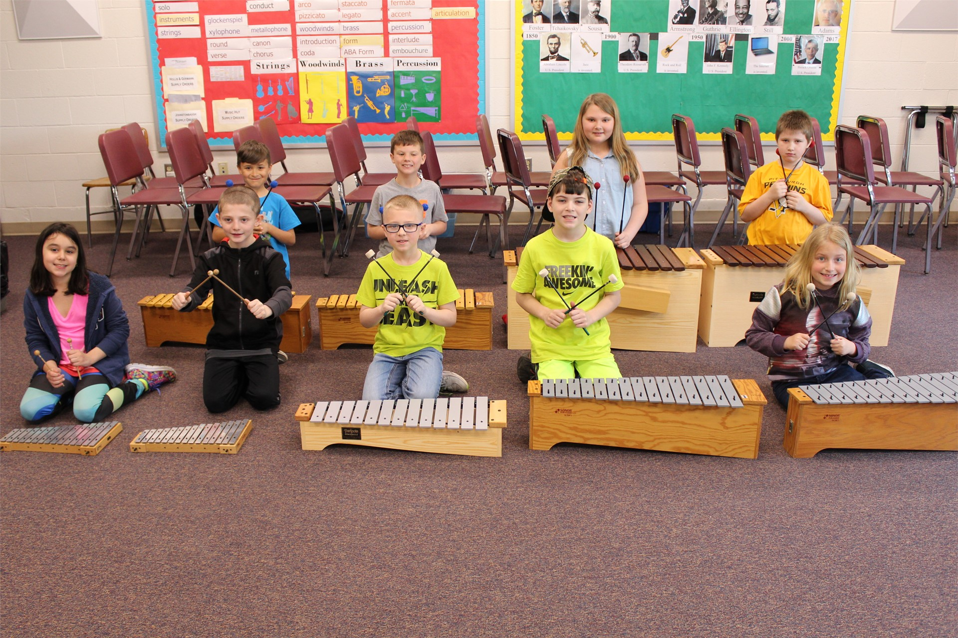 Music students provide musical accompaniment to a play performed for kindergarten students