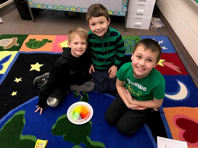 First Graders experiment with Skittles candies