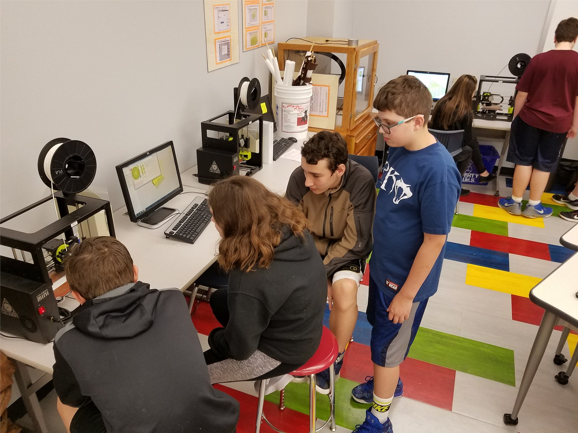 students working with 3-d printers