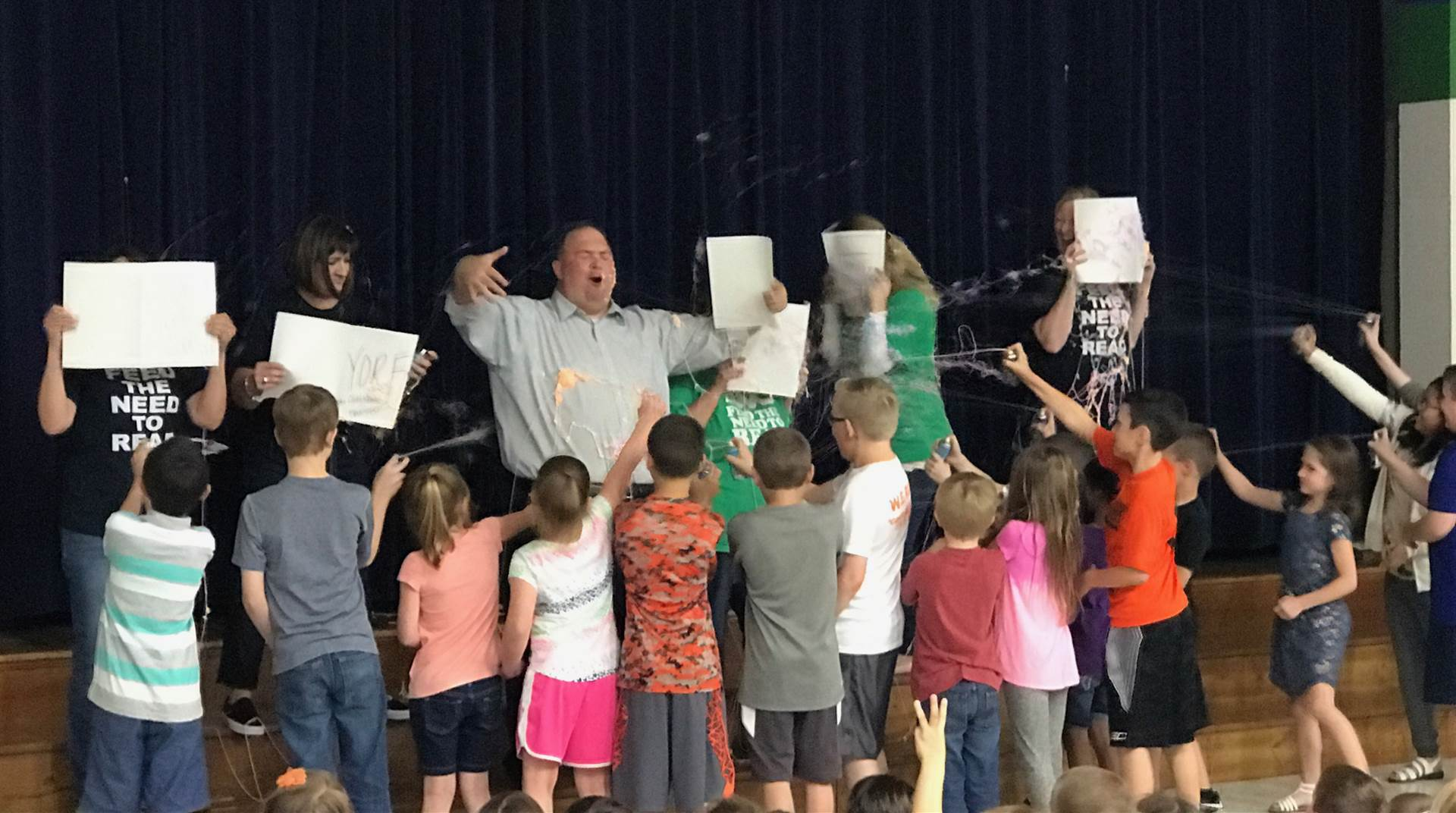 Students spray their Principal with Silly String for meeting their reading goals