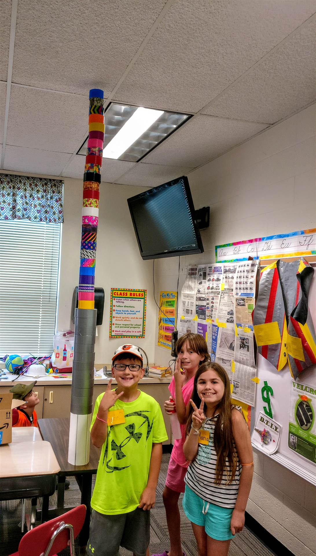 These students constructed a paper base that would hold enough rolls of duct tape to reach the ceili