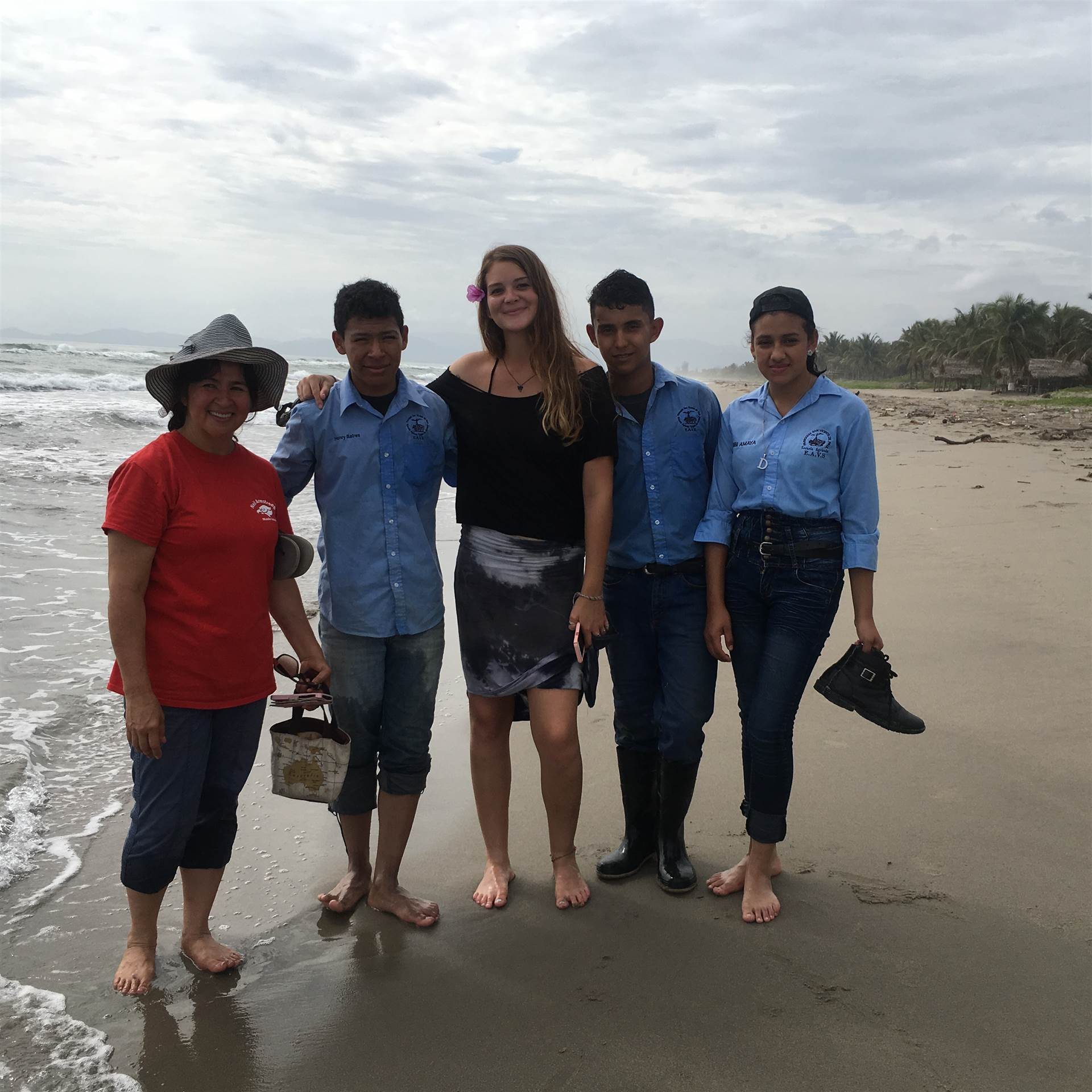 Mrs. Leonard (left), Anwin Darrow (center) and some Honduran students on the beach.