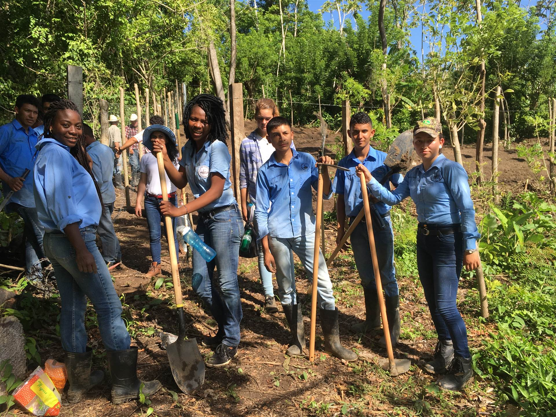 Honduran students begin to plant their organic garden.