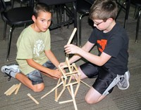 Students add height to their towers