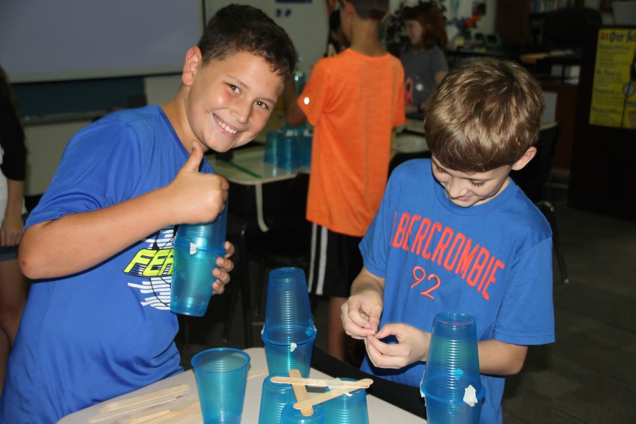 Students are all smiles when they work on the Weekly STEAM Challenge