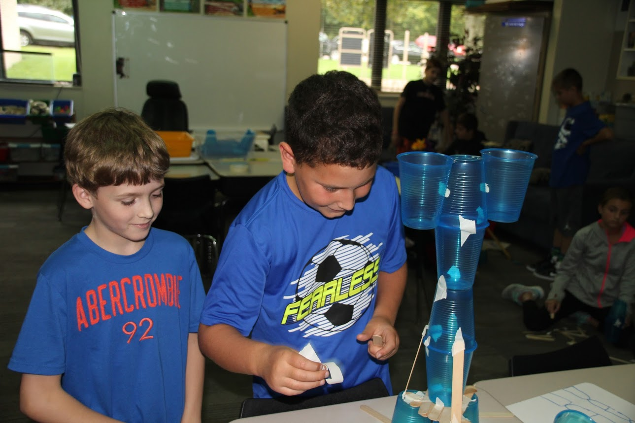 Students work together on the Weekly STEAM Challenge