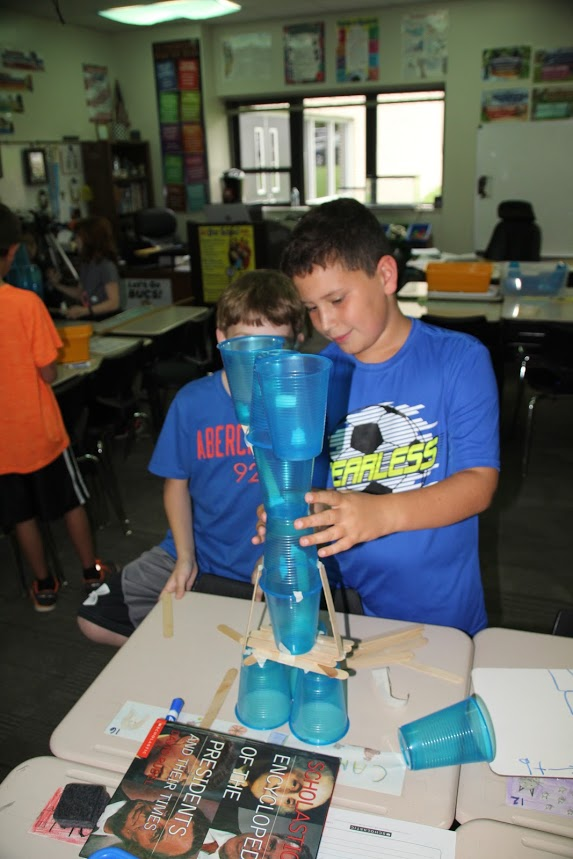 The students try to build their towers as high as they can.