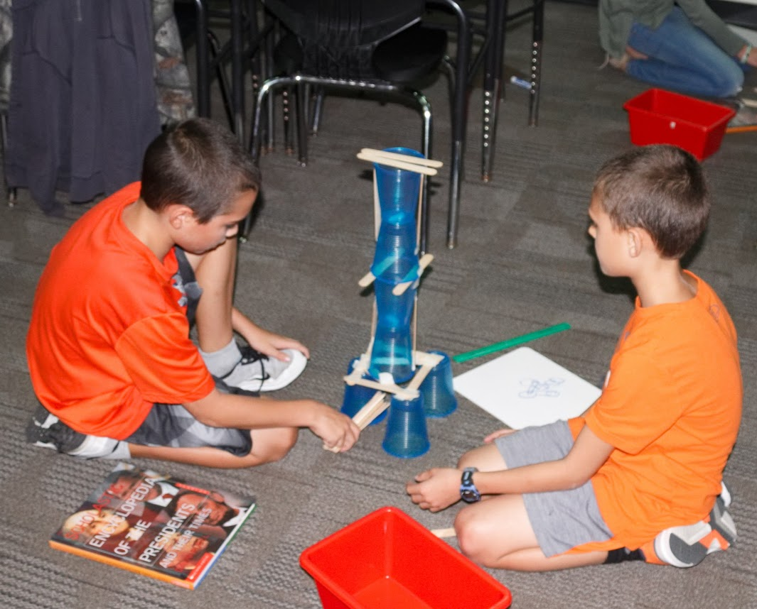 Students work to strengthen their tower