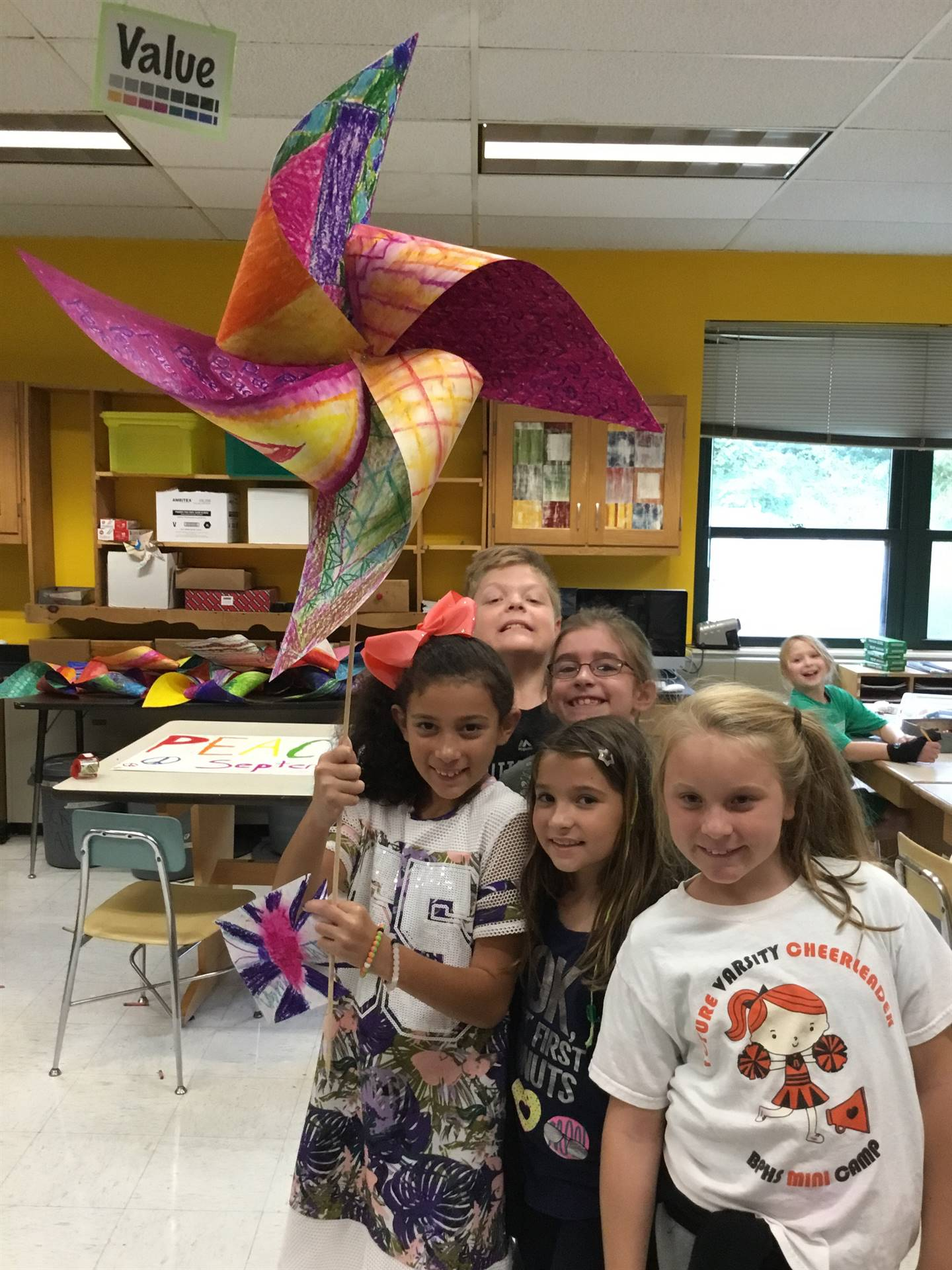 Memorial students and a giant Pinwheel for Peace
