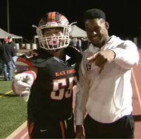 JuJu Smith-Schuster and a BPHS Football Player on the sidelines