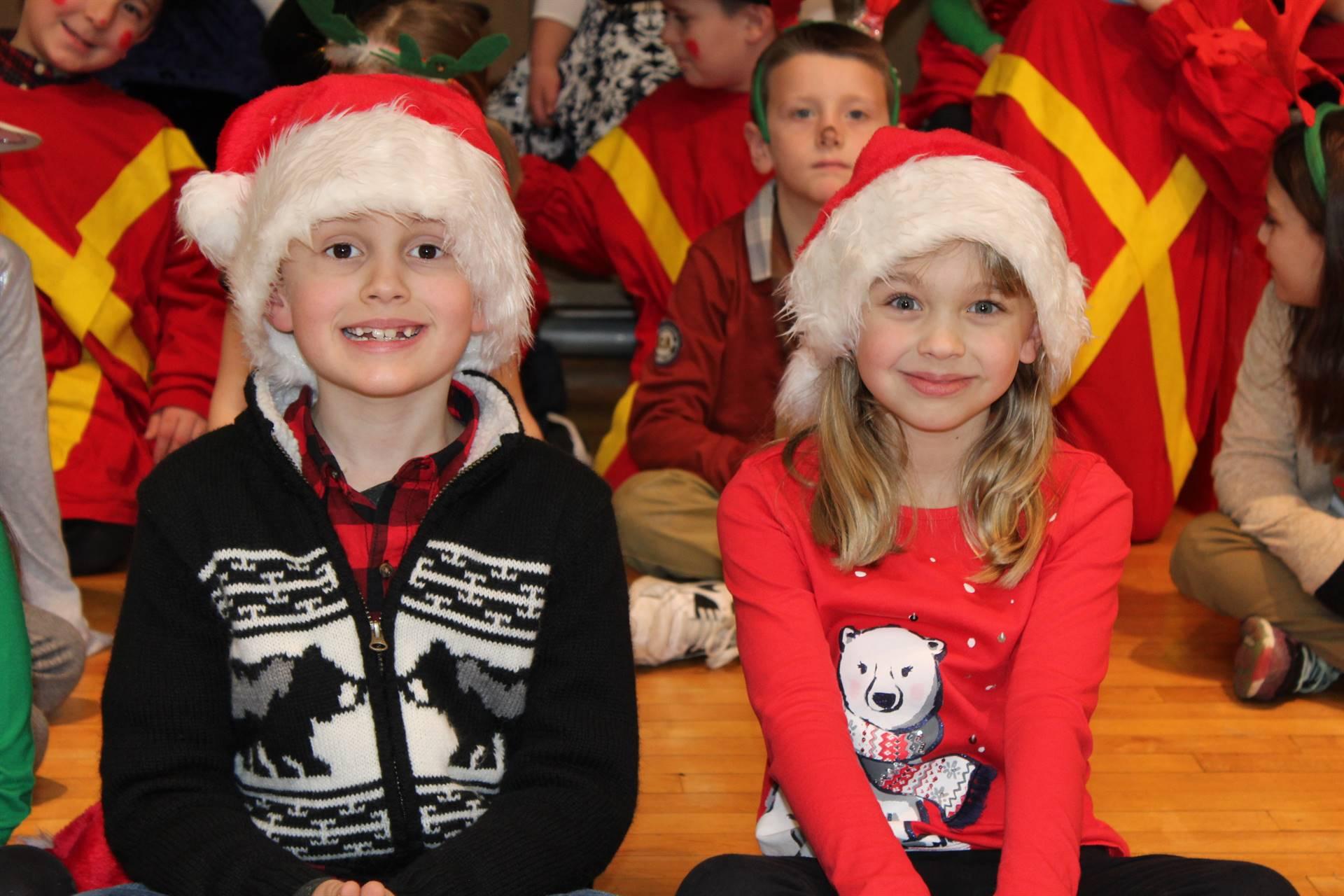 two students wearing Santa hats