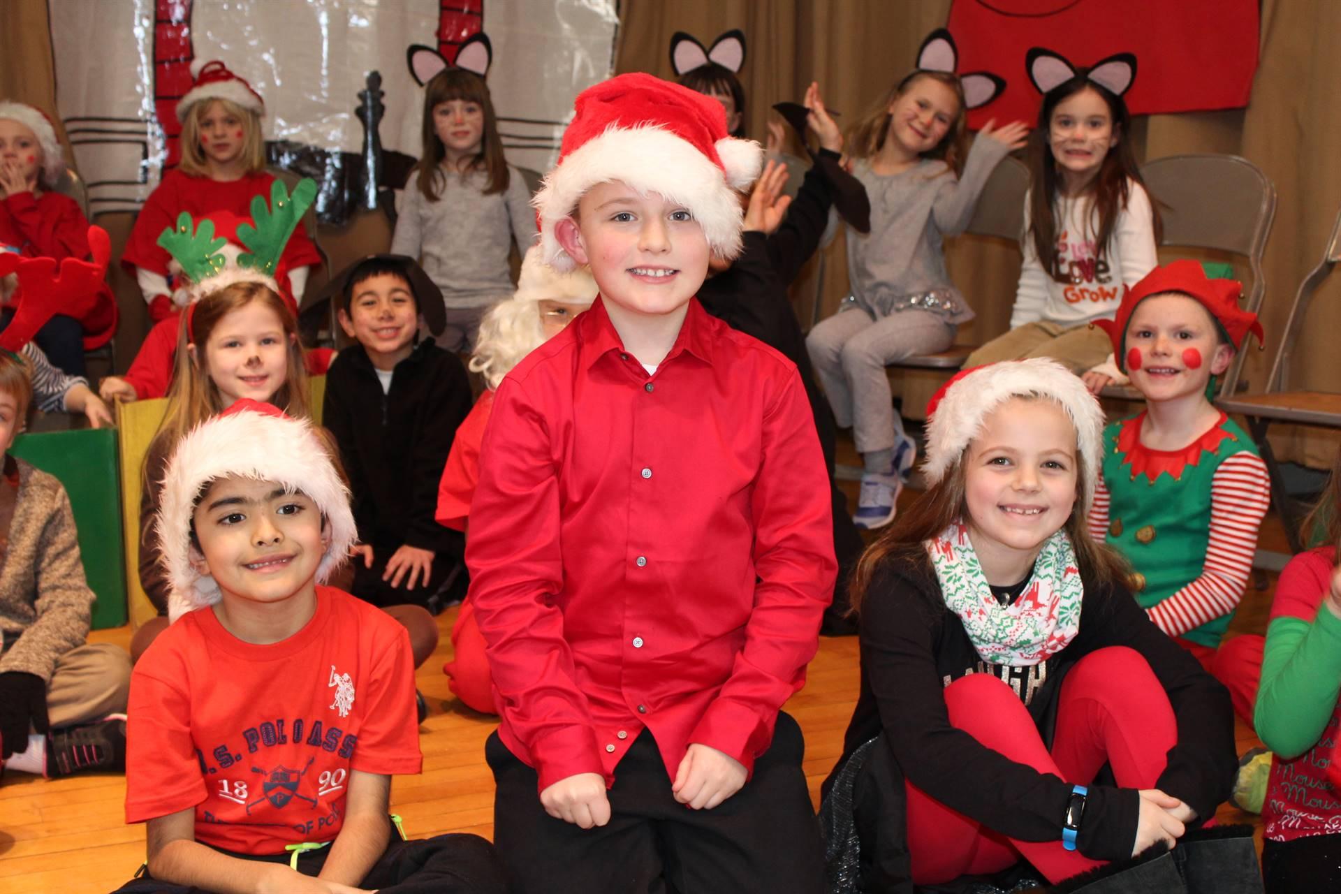 three children wearing Santa hats