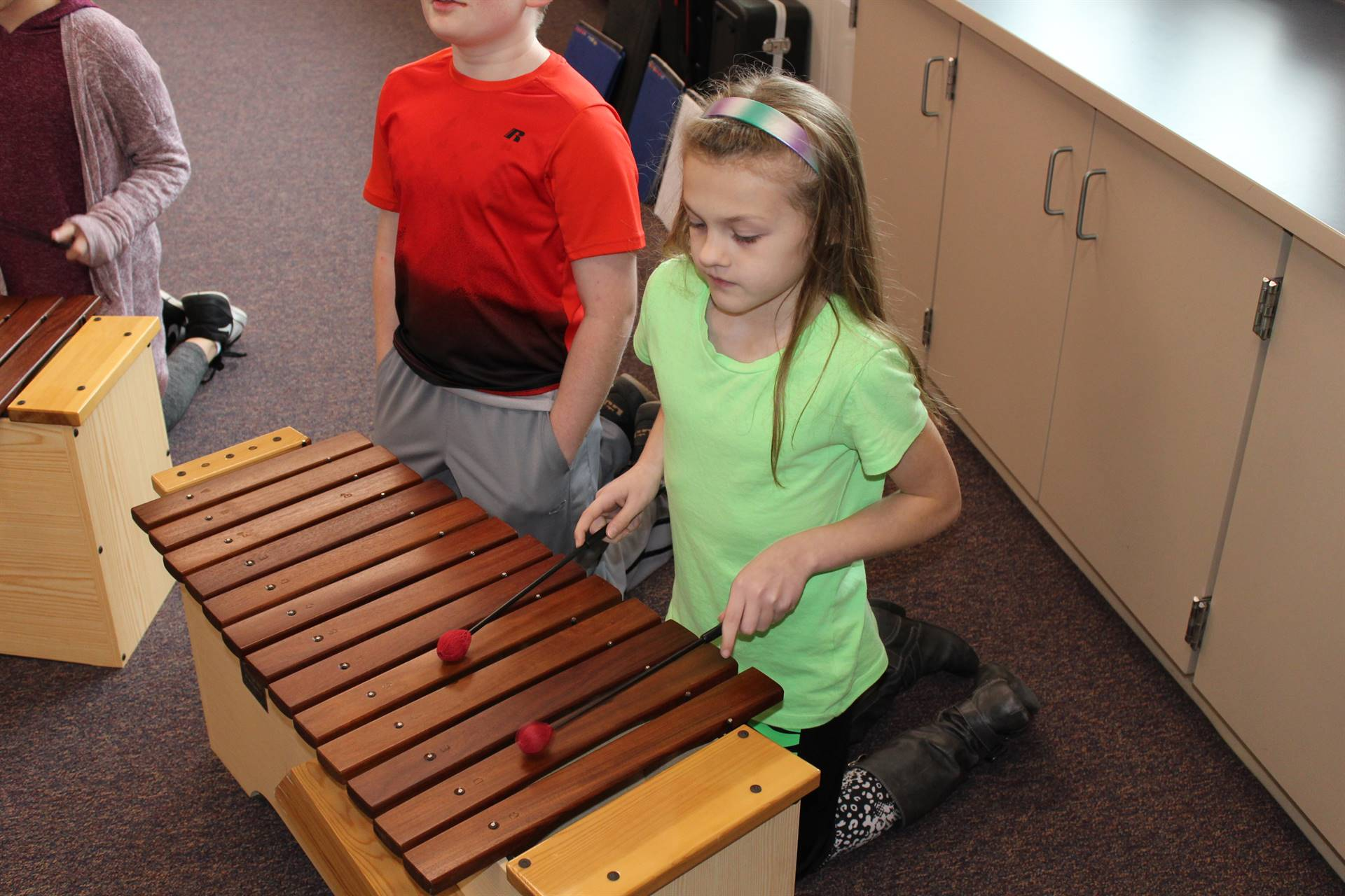 Student playing a xylophone