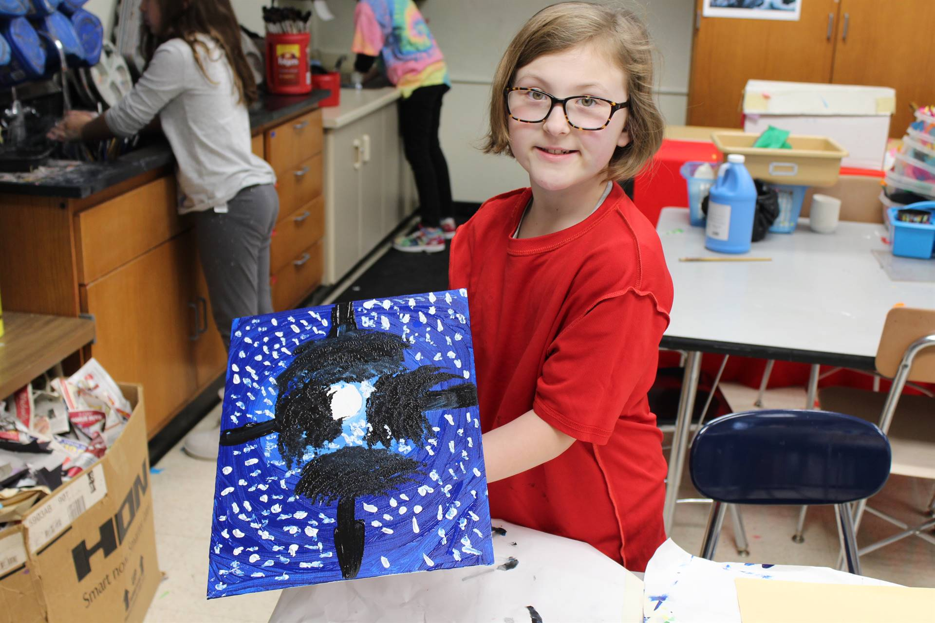 Fourth Graders paint on real canvas