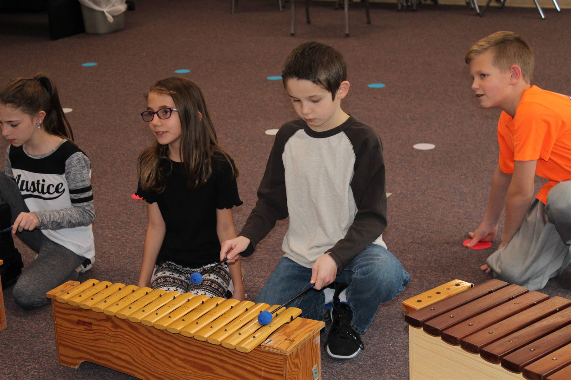 Fourth graders playing xylophones