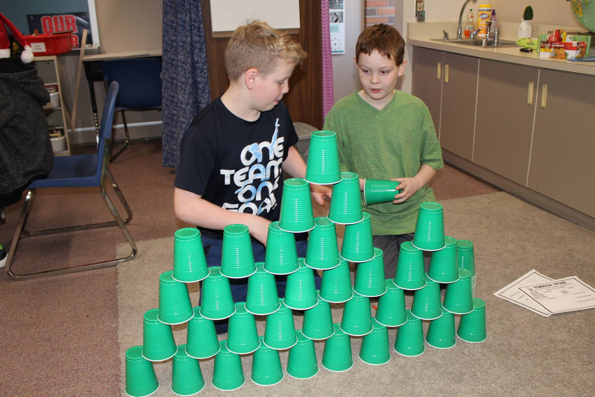 Students making a Christmas tree out of plastic cups