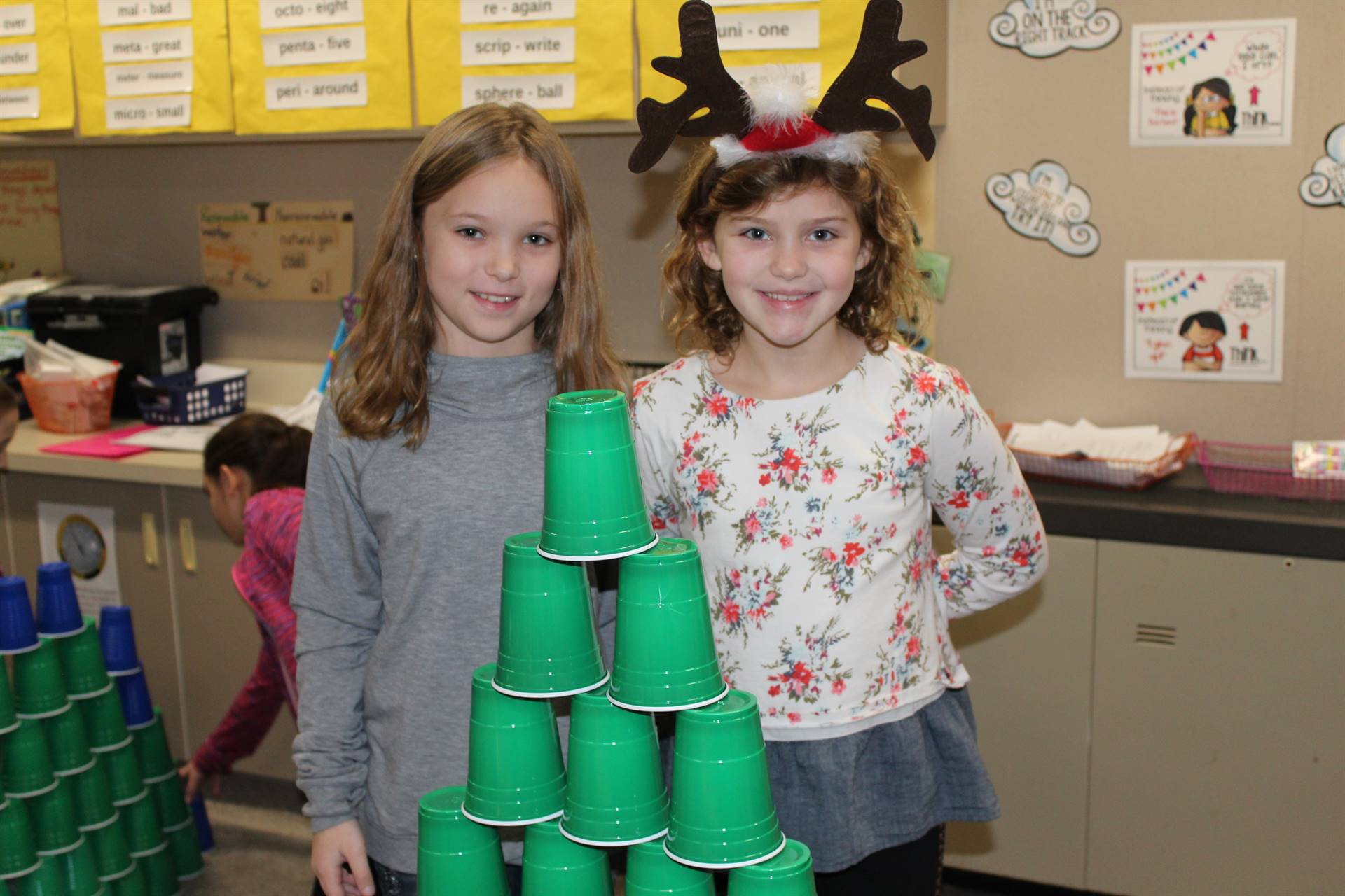 Students with their plastic cup Christmas tree