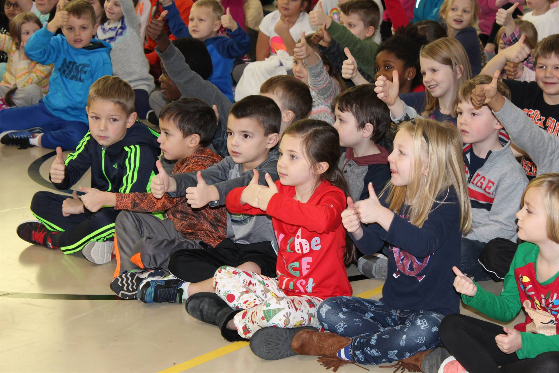 Students giving a thumbs up at the Squonk Opera Assembly