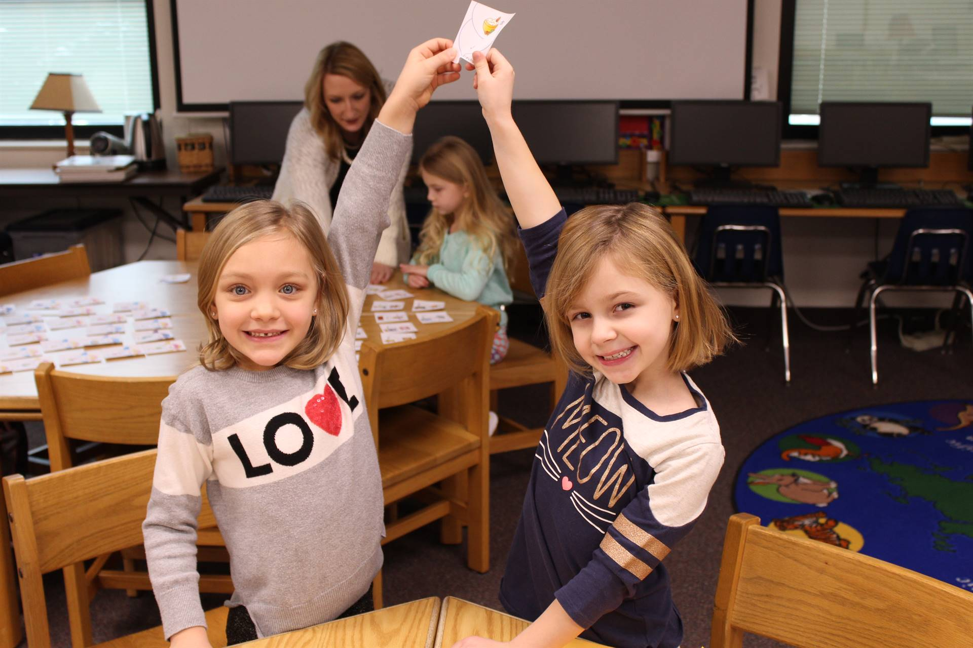 Students holding up a snowman card