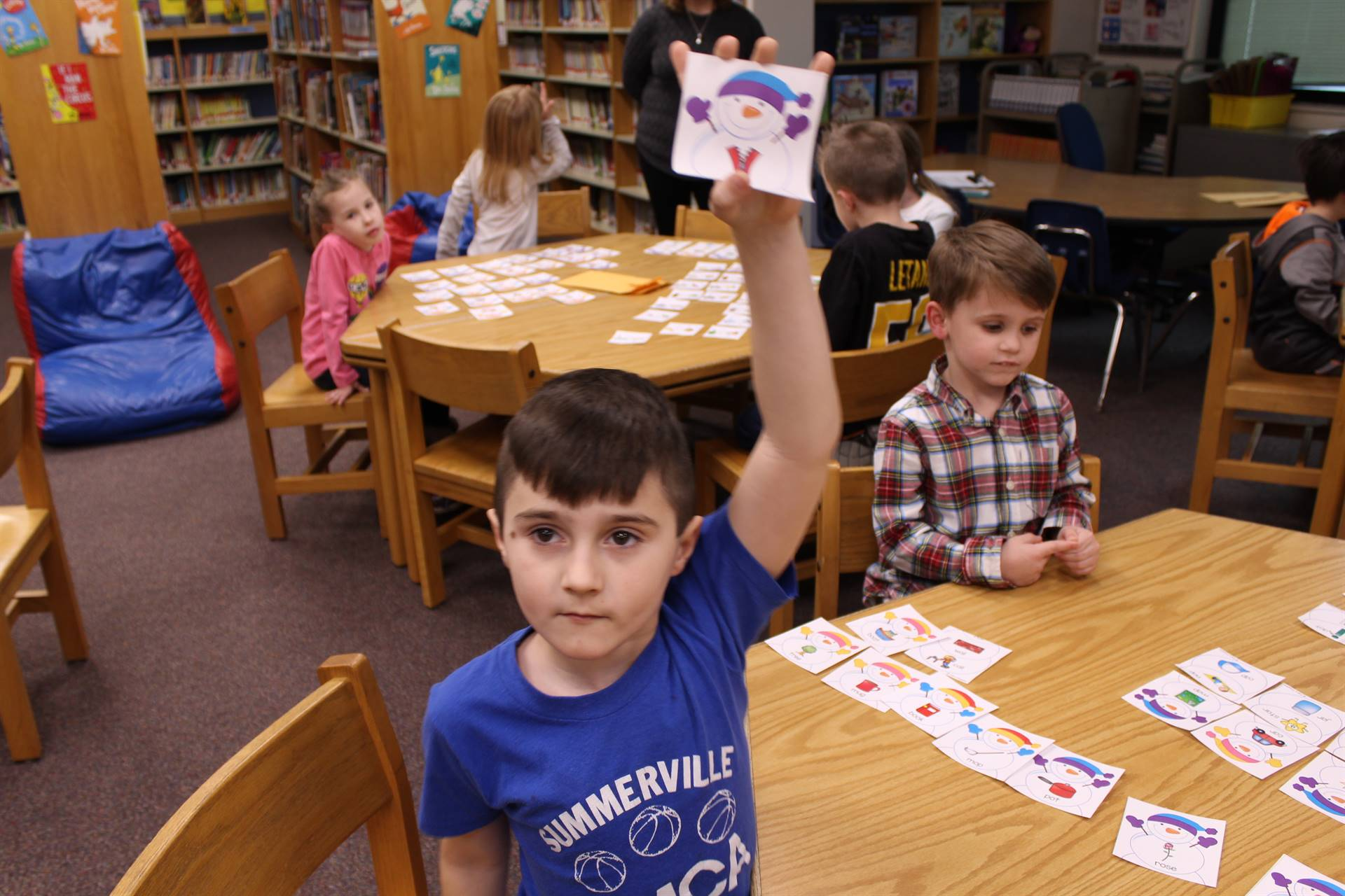 Student holding up a snowman card
